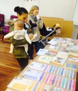 Mums looking at LLL info at LLL Shipley group meeting