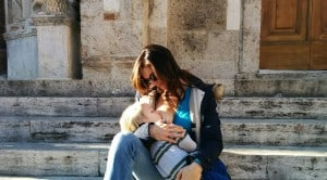 beautiful italian mother nursing toddler on stone steps